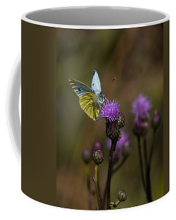 Coffee Mug featuring the photograph White And Yellow Butterfly On Thistl by Leif Sohlman