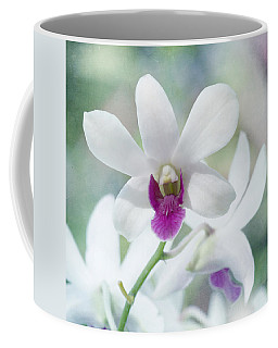 Coffee Mug featuring the photograph White Orchid by Kim Hojnacki