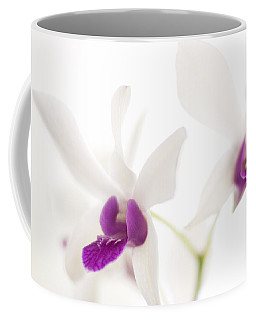 Coffee Mug featuring the photograph White Orchids by Bradley R Youngberg
