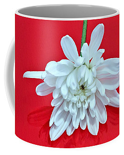 White Flower On Bright Red Background Coffee Mug
