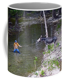 Coffee Mug featuring the photograph Who Is More Stubborn by John Glass