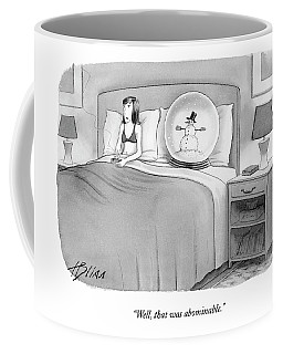 Woman In Bed With A Huge Snow-globe Coffee Mug