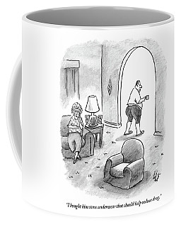 Woman Speaks On Phone As Her Husband Stands Coffee Mug
