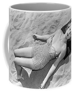 Woman Sun Bathing At The Beach Coffee Mug