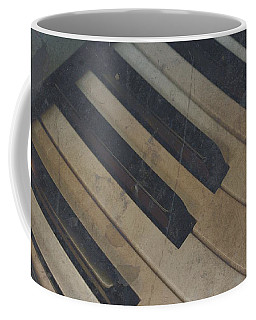 Coffee Mug featuring the photograph Worn Out Keys by Photographic Arts And Design Studio