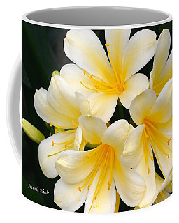 Coffee Mug featuring the photograph Clivia Yellow Flowers by Jeannie Rhode
