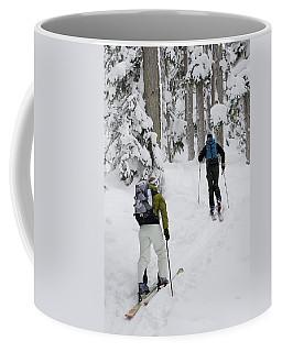 Young Adults Ski-tour Through Forest Coffee Mug