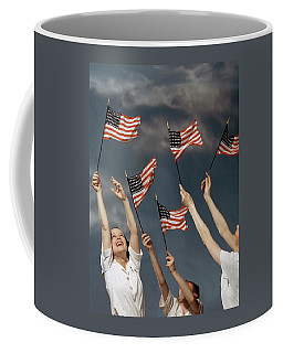 Young Women Waving American Flags Coffee Mug