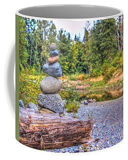 Coffee Mug featuring the photograph Zen Balanced Stones On A Tree by Eti Reid