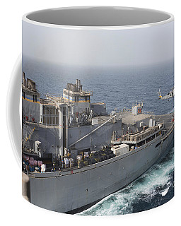 A Sh-60j Seahawk Conducts A Vertical Coffee Mug