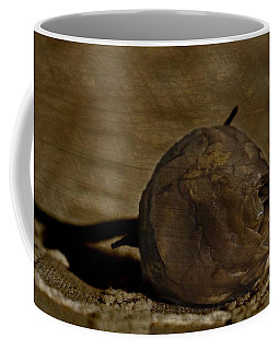 Coffee Mug featuring the photograph Dead Rosebud by Steve Purnell