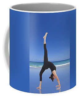 Woman Doing Yoga On The Beach Coffee Mug