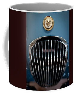 Coffee Mug featuring the photograph 1952 Jaguar Hood Ornament And Grille by Sebastian Musial