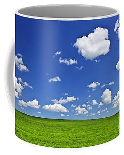 Green Rolling Hills Under Blue Sky Coffee Mug