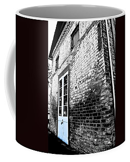 Coffee Mug featuring the photograph A Bit Of Blue by Mitch Shindelbower