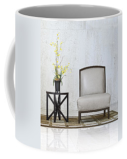 A Chair And A Table With A Plant  Coffee Mug
