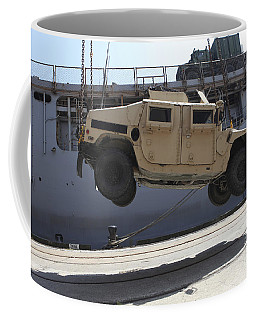 A Crane Lifts An M998 Humvee Coffee Mug