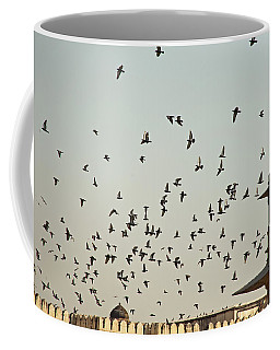 A Flock Of Pigeons Crowding One Of The Structures On Top Of The Red Fort Coffee Mug by Ashish Agarwal