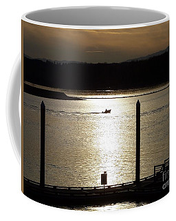 A Lone Boat At Sunset Coffee Mug