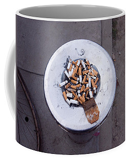 A Lot Of Cigarettes Stubbed Out At A Garbage Bin Coffee Mug by Ashish Agarwal