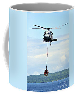 A Mh-60 Knighthawk Carries Supplies Coffee Mug