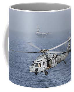 A Mh-60s Knighthawk Conducts A Vertical Coffee Mug