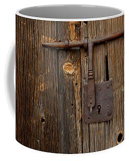 A Rusty Barn Door Lock On An Old Coffee Mug