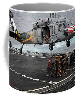 A Sailor Hooks Cargo To An Mh-60s Sea Coffee Mug