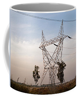A Transmission Tower Carrying Electric Lines In The Countryside Coffee Mug by Ashish Agarwal
