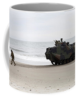 A U.s. Marine Guides An Amphibious Coffee Mug