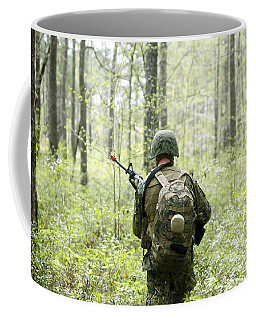 A U.s. Marine Patrols Through A Forest Coffee Mug