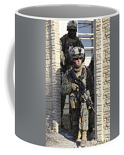 A U.s. Marine Provides Security While Coffee Mug