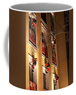 Coffee Mug featuring the photograph A Wall Of Sneaky Santas by Lorraine Devon Wilke