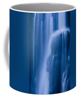 A Waterfall Splashes Off Of A Large Coffee Mug