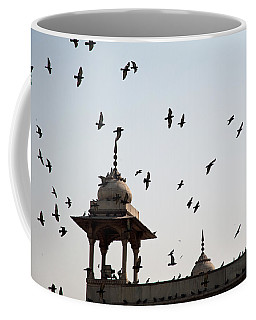 A Whole Flock Of Pigeons On The Top Of The Ramparts Of The Red Fort In New Delhi Coffee Mug by Ashish Agarwal