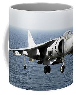 An Av-8b Harrier Hovers Over The Flight Coffee Mug