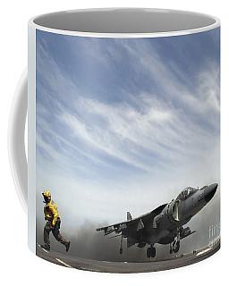 An Av-8b Harrier II Performs A Vertical Coffee Mug