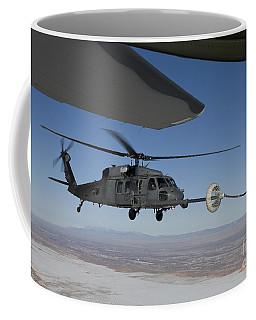 An Hh-60g Pave Hawk Conducts Aerial Coffee Mug