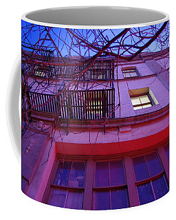 Coffee Mug featuring the photograph Apartment Building by Marilyn Wilson