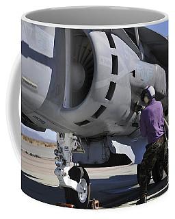Aviation Fuel Technician Attaches Coffee Mug