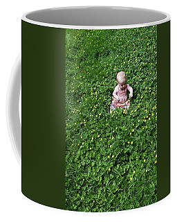 Baby In A Field Of Flowers Coffee Mug