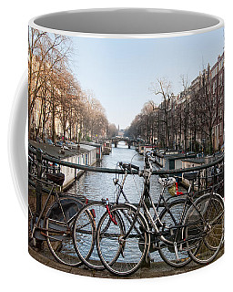 Coffee Mug featuring the digital art Bikes On The Canal In Amsterdam by Carol Ailles