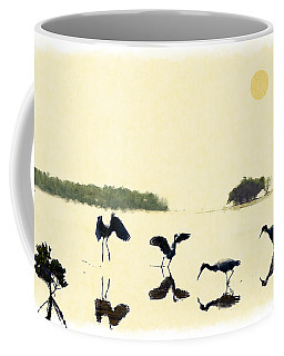 Coffee Mug featuring the photograph birds feeding in the Everglades by Dan Friend