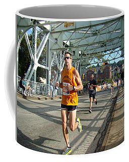 Coffee Mug featuring the photograph Bridge Runner by Alice Gipson