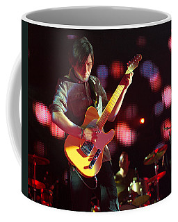 Coffee Mug featuring the photograph Bright Eyes by Jeff Ross