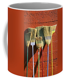 Brooms Leaning Against Wall Coffee Mug
