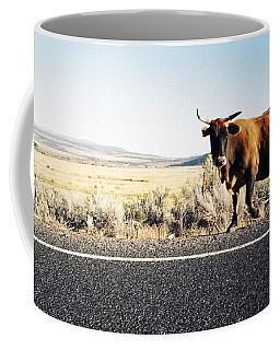 Bull On The Road Coffee Mug by Peter Mooyman