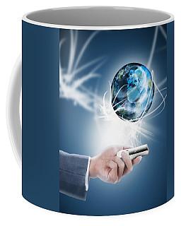 Businessman Holding Mobile Phone With Globe Coffee Mug