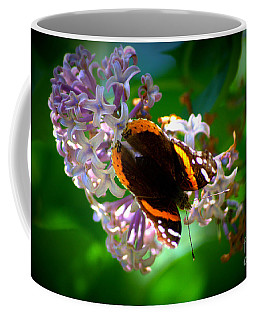 Butterfly On Lilac Coffee Mug by Kevin Fortier