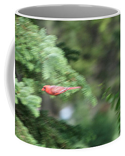 Coffee Mug featuring the photograph Cardinal In Flight by Thomas Woolworth